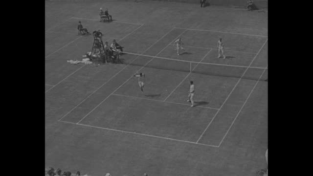 """""""headlines in sports"""" / title: """"forest hills, l.i."""" superimposed over tennis players holding racquets and entering tennis court at west side tennis... - davis cup stock-videos und b-roll-filmmaterial"""