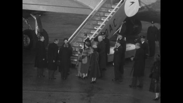 her majesty leaves for nigeria / queen elizabeth ii wearing fur coat and prince philip duke of edinburgh walk across airfield at heathrow airport... - the queen stock videos and b-roll footage