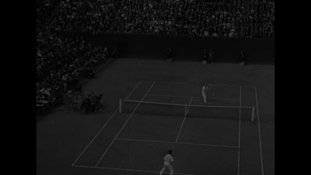 here is sensational play for davis cup cochet of france stops brilliant bid by allison for singles victory / tennis court at rolandgarros stadium... - 1932 stock videos & royalty-free footage