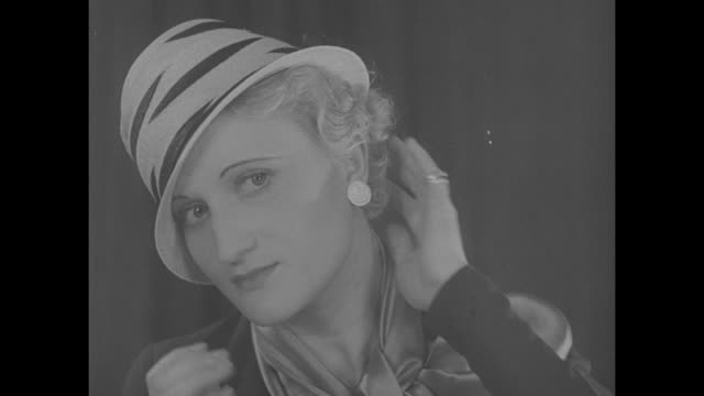 "stockvideo's en b-roll-footage met ""here's real headwork! paris - nudge your husband! madame agnes, french milliner, gives you a peep at the new summer hat styles - and hopes you like... - 1930"