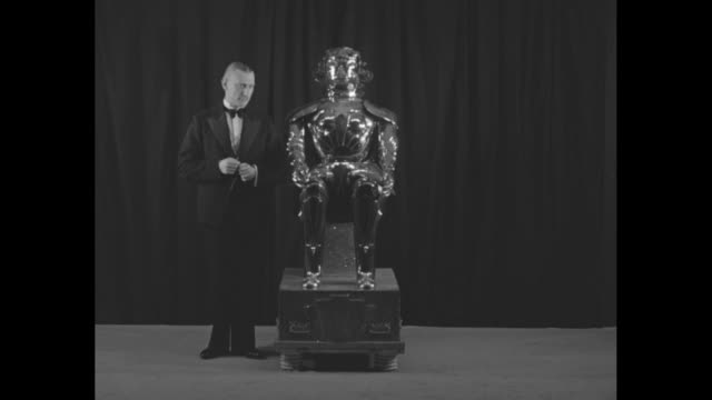 """he's not from mars! all metal, but talks and acts like you and i! professor harry may of england exhibits robot perfected after 20 years."" /... - alpha cell stock videos & royalty-free footage"