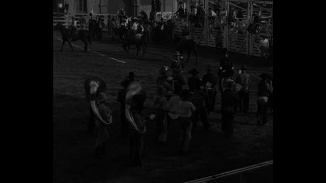 'high flying' cowboys los angeles going up and off airminded steers and broncos give 'pilots' real thrills in west's biggest winter rodeo / marching... - bocksprång bildbanksvideor och videomaterial från bakom kulisserna