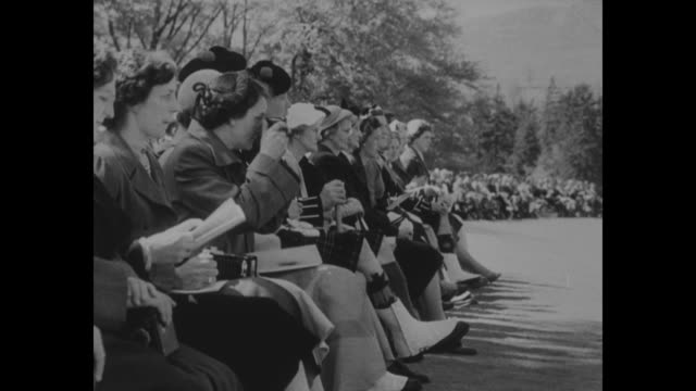 highlanders receive colors from queen superimposed over cameron highlanders at balmoral / elizabeth and philip review lines of highlanders / crowd of... - duke of edinburgh stock videos and b-roll footage