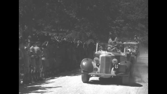 """""""his majesty honours indian hero; canadian paramount news; voice: winston barron"""" / king george vi rides in car past by crowd of cheering canadian... - basco video stock e b–roll"""