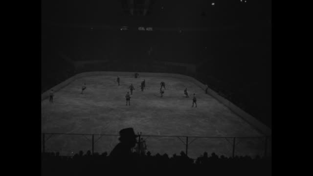 """hockey start fight for cup in playoffs"" / title superimposed on hockey rink, ""new york"" / high angle views of game / note: exact year not known - playoffs stock videos & royalty-free footage"