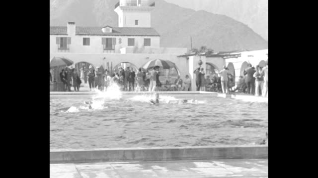 hold first desert diving competition palm springs cal world champs gather in new pool under shadow of towering mt jacinto / people in el mirador... - palm springs california stock videos & royalty-free footage