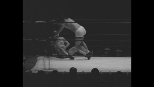 'Hold That Scissors Los Angeles – Another round in the gay game of 'who's the camp' Jim Browning and Sammy Stein grunt and groan in wild wrestling...