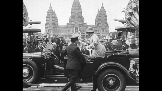 vídeos de stock e filmes b-roll de holland's queen takes a holiday dutch ruler wilhelmina accompanied by princess juliana visits the great colonial exposition in paris / ls open top... - 1931