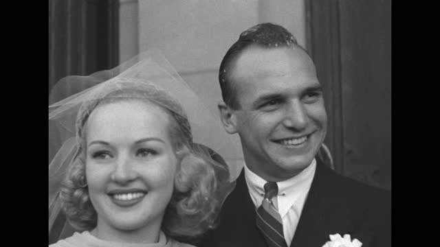 """""""hollyweds - cupid joins jackie coogan and betty"""" / shot of exterior of st. brendan's catholic church / jackie coogan and betty grable leaving church... - black and white stock videos & royalty-free footage"""