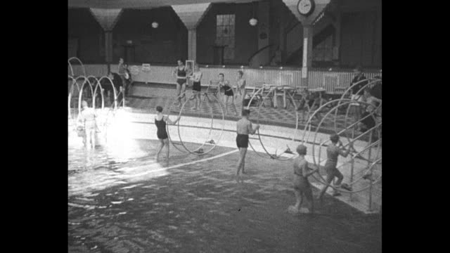 hoops my dear it's the newest german sport experts who roll their own that to synthetic turf of berlin pool in spectacular display of skill / women... - lifestyles stock videos & royalty-free footage
