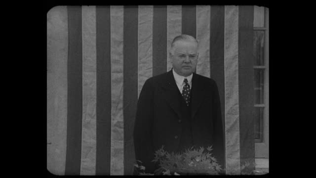 hoover attacks new deal former president opens '36 campaign at oakland banquet of young republicans / ws of hoover speaking large us flag hanging... - herbert hoover us president stock videos & royalty-free footage