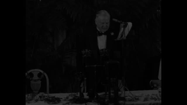 vídeos de stock, filmes e b-roll de hoover hits at 'playboys' of new deal / audience at tables at the john marshall republican club applauds as former us president herbert hoover is... - nova negociação