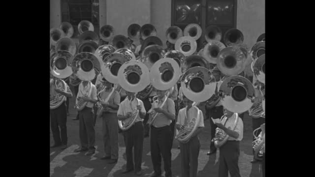 horns stutter in tootin' test elkhart ind latest wind instruments for school bands blare in final test / big group of people playing trumpets / title... - trombone stock videos & royalty-free footage