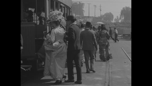 horsecar startles modern trafficdowntown los angeles sees pioneer trolley hauled by old dobbins over route it covered 50 years ago / women and men... - pedestrian stock videos & royalty-free footage