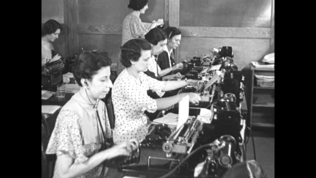 how us plans to help aged / office of women typing and shuffling papers / new york state old age pension headquarters / sots elderly man applicant... - 年金点の映像素材/bロール