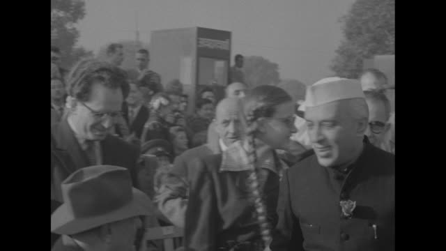 """huge parade marks india's `republic day'"" superimposed over uniformed men riding horses iin parade / prime minister jawaharlal nehru shakes hands in... - constitution stock videos & royalty-free footage"