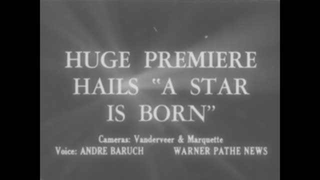 """""""huge premiere hails 'a star is born'"""" / night: flashing marquee touts """"a star is born,"""" with crowds and police officers below / danny thomas and... - theater marquee commercial sign stock videos & royalty-free footage"""