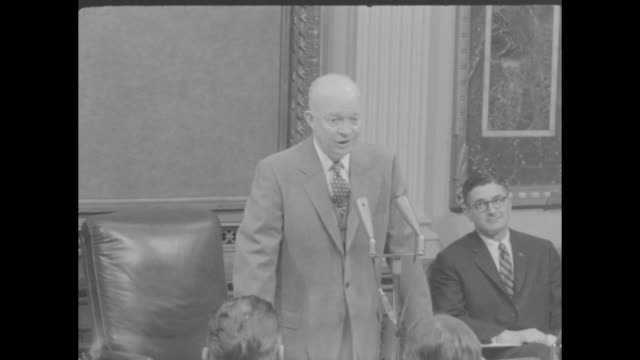 'ike says nixon must chart his own course' superimposed over eisenhower arriving at press conference / male and female journalists glancing up and... - sideways glance stock videos & royalty-free footage
