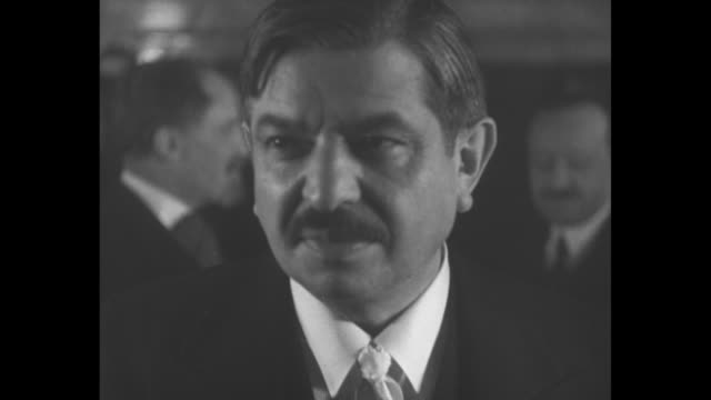 m pierre laval a rome… / high angle ws french foreign minister pierre laval at left and italian dictator benito mussolini at right emerge from... - top hat stock videos & royalty-free footage