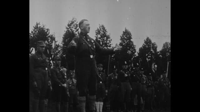 title card in german loose translation germany's freedom will rise again like the people and the fatherland will stronger than ever / adolf hitler... - braun stock-videos und b-roll-filmmaterial