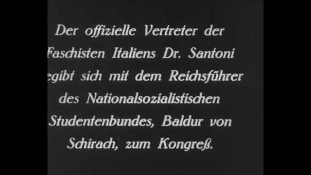 title card in german regarding meeting between dr santoni of italy and leader of the national socialist german students' league baldur von schirach /... - cravat stock videos and b-roll footage
