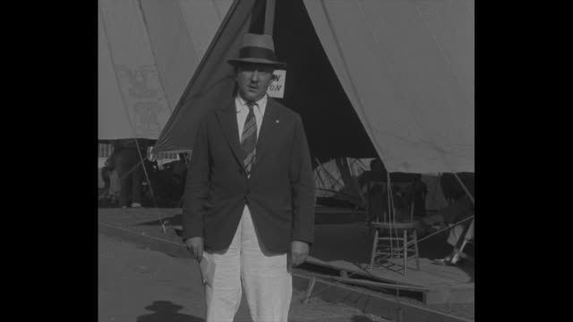 """""""in tragedy's wake! american red cross, led by ernest swift, begins relief work among stricken people"""" / swift, standing in front of tent, speaks to... - managua stock videos & royalty-free footage"""