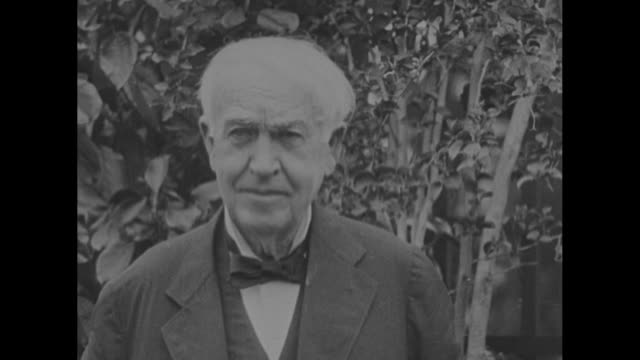 """""""in tribute to thomas alva edison on the 86th anniversary of his birth february 11th 1847"""" / edison posing for photo opportunity / edison sitting in... - ヘンリー・フォード点の映像素材/bロール"""