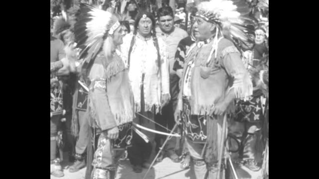 indians make governor chief pittsville wis winnebagos honor governor kohler with tribal powwow / wi gov walter kohler sr facing chief both wearing... - interlocked stock videos & royalty-free footage