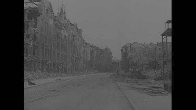stockvideo's en b-roll-footage met inside berlin 1st films in 5 years / group of allied officers standing by cars on street in wrecked city bombedout buildings in bg / pan of destroyed... - puin
