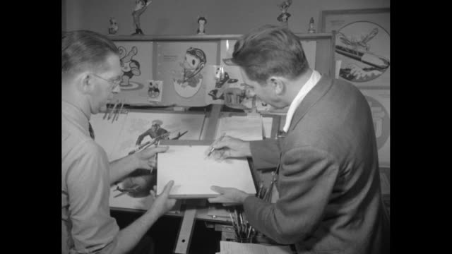 'insignia disney drawings for u s fighting forces / group of artists looks at drawings in disney company studio walt disney enters with back to... - disney stock videos and b-roll footage