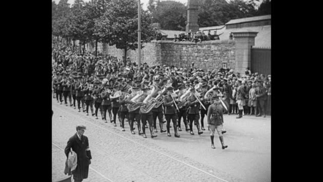 'Irish Catholics Mark Freedom Dublin 300000 observe anniversary of religious emancipation at Mass' / military band marching down street playing crowd...