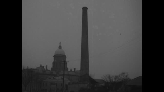 """""""irish down stack! notre dame students tackle 180-foot chimney at south bend, ind."""" / shot of smoke stack on campus of notre dame, with golden dome... - reverse motion stock videos & royalty-free footage"""