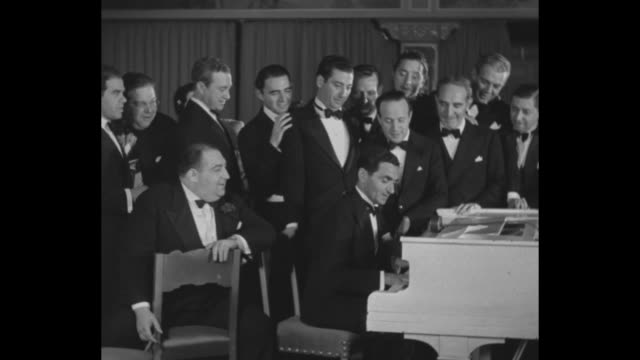 irving berlin jubilee / large party for composer irving berlin's 25th anniversary / partygoers singing everybody's doin' it now / berlin on piano /... - cheek to cheek stock videos & royalty-free footage