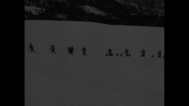 """italy's alpine get set! alps - il duce's ski brigades in winter maneuvers near austrian border! 20,000 troops reported on march as vienna situation... - dragging stock videos & royalty-free footage"