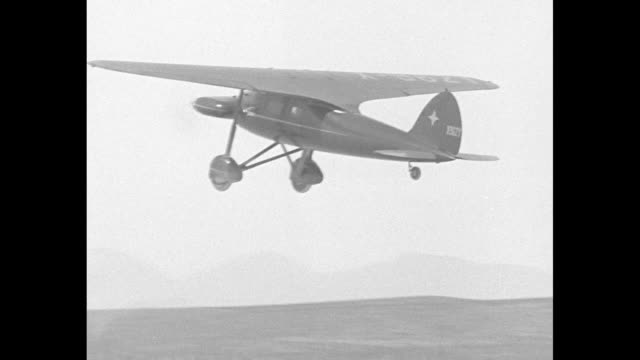 it's all in the game muroc califoh for a cameraman's life novel plane with twin engines mounted horizontally gives a real thrill / cu monoplane with... - bremskeil stock-videos und b-roll-filmmaterial