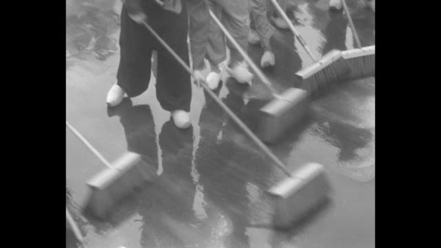 it's tulip time in holland so michigan gets a dutch treat inhabitants of holland mich join in grand cleanup which marks festival / two shots of row... - scrubbing up stock videos and b-roll footage