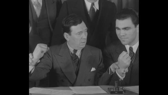 """""""jack for max new york with jimmy johnson as promoter max schmeling world champ signs for return bout with jack sharkey"""" / boxing promoter jimmy... - world title stock videos and b-roll footage"""