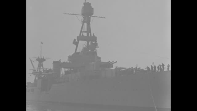 'Japan Hails US Admiral Tokyo Hands across the Pacific Admiral Upham chief of US Asiatic Fleet pays Japan goodwill call' / shot of USS Augusta at...