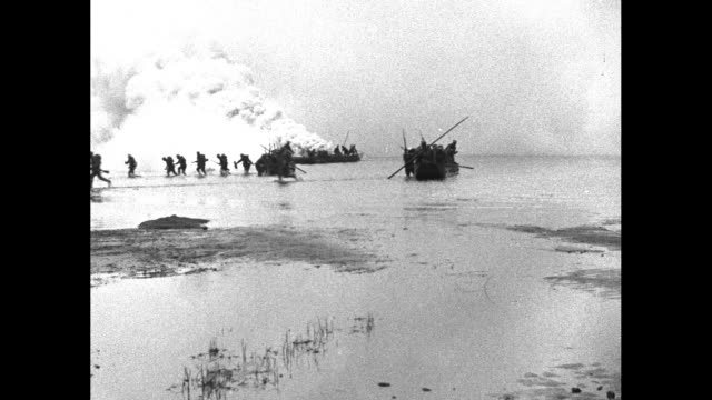 stockvideo's en b-roll-footage met japan raids china / vs japanese troops headed for china shore in rowboats / disembarking and running through water to shore / walking shot of... - militaire invasie
