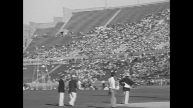 javelin throw won by jarvenin [sic] finland no 118 distance 238 ft 7 in new olympic record / finnish athlete trots while holding javelin picks up... - 1932 stock videos & royalty-free footage