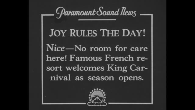 'Joy Rules The Day Nice No room for care here Famous French resort welcomes King Carnival as season opens' / costumed people dance in circles in Nice...