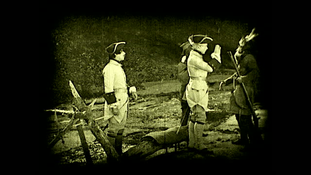 """stockvideo's en b-roll-footage met """"jumonville concealed his force in a shadowy glen -- not far from great meadows""""; french soldiers making camp near the river, cooking, eating, and... - city of neighbors: give once for all film title"""
