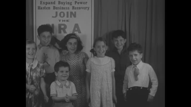 junior nra army formed in boston boys and girls of bay state enroll under the blue eagle / cu child / ms group shot of children in front of national... - hair bow stock videos & royalty-free footage