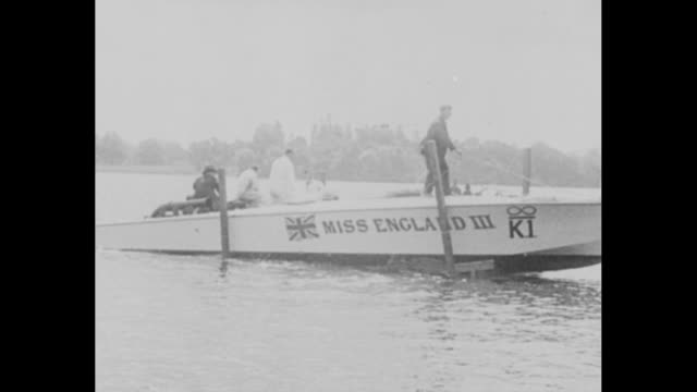 vídeos de stock, filmes e b-roll de kaye don rules the speed waves for britain again and here is miss england iii in which he set new world mark on loch lomond / crew member eases miss... - loch