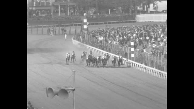 kentucky derby superimposed over end of race / crowd outside churchill downs / aerials crowd inside churchill downs and empty track / horses being... - 1936 stock-videos und b-roll-filmmaterial