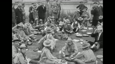 """stockvideo's en b-roll-footage met """"king alphonso talks with boy scout officials"""" / boy scouts sitting around on ground / alfonso xiii talking with boy scout officials / note: exact... - democratie"""