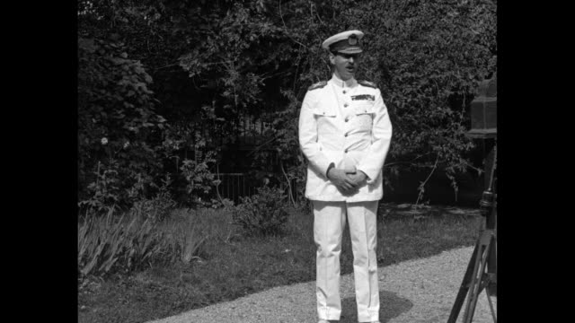 'King Carol II New monarch back in triumph after exile sends greetings to America' / WS Carol II of Romania stands outdoors wearing white military...