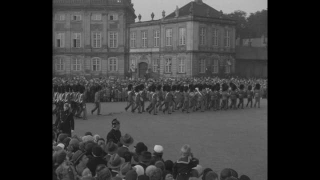 king gets a party copenhagenchristian x 62 years old thousands surround amalienborg palace to hail their beloved monarch / ms royal guards parade in... - palace stock videos & royalty-free footage