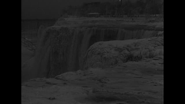 King winter holds nation in icy grip Niagara Falls frozen as year's coldest spell sweeps country / view of iced falls with diminished water falling /...