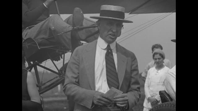 vídeos de stock, filmes e b-roll de learn flying in glider on auto greensburg pa inventor harry traver explains newest device to train student pilots / harry traver in straw boater... - inventor